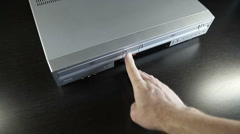 DVD Player-insert DVD top view wide MVI-4709 Stock Footage