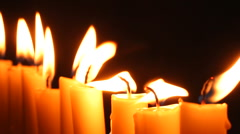 Candle light. Track beside a row of flickering burning candles. Stock Footage
