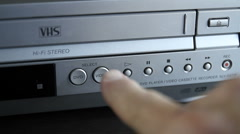 VHS Player-select DVD & VHS buttons MVI-4715 Stock Footage