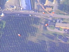 Parachutes deployed, zoom back from above to reveal earth Stock Footage