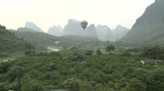 Aerial shot in hot-air balloon view of of karst peaks Stock Footage