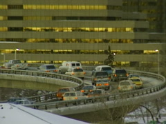 Gloomy early morning rush hour traffic on curved bridge Stock Footage