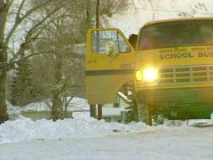 Weather, snowy morning kids leaves school bus van Stock Footage