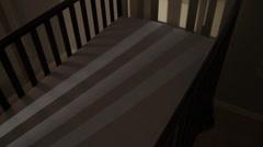 Empty crib in dim nursery Stock Footage