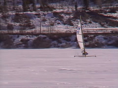Extreme winter sport, Ice sail boat #7 fly-by from mid point on lake Stock Footage