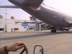 tug driving under wing A310 - stock footage