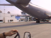 Tug driving under wing A310 Stock Footage