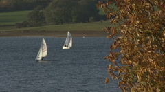 Dinghies sail on Rutland Water. Stock Footage