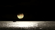 Stock Video Footage of Lone fishing boat at night 3