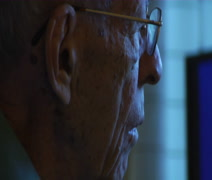 Elderly man watching tv Profile ECU Stock Footage