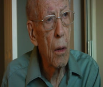 Elderly man watching TV using remote control Stock Footage