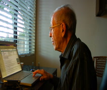 Elderly man reading e-Mail on laptop Stock Footage