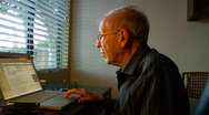 Stock Video Footage of Elderly man reading e-Mail on laptop