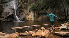 Waterfall 02 - Boy walking on rocks - stock footage