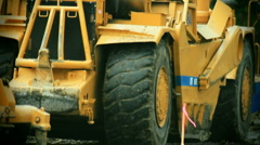 Tractors-earthmover-bulldozer-water truck move - stock footage
