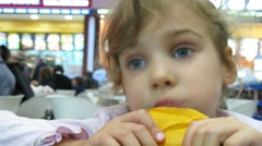 Little girl dinning in hypermarket Stock Footage