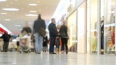 People pass through passage in Aushan hypermarket Stock Footage