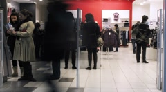 People shop in clothing store Stock Footage