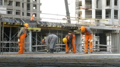 Workers at construction site at Losiniy Ostrov estate Stock Footage