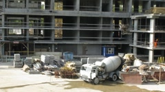 Concrete mixer operates at construction site Stock Footage