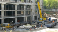 Crane operates at construction site at Losiniy Ostrov estate Stock Footage