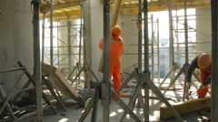 Workers build scaffolding at Losiniy Ostrov estate Stock Footage