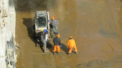Workers dip out water on construction site at Losiniy Ostrov estate Stock Footage