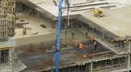 Workers pour concrete using concrete pump at Losiniy Ostrov estate Stock Footage