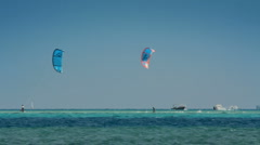 Kite surfing - surfers on blue sea surface - timelapse Stock Footage
