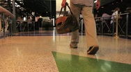 Man Walking through Airport with Bag Stock Footage