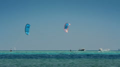 Kite surfing - surfers on blue sea surface Stock Footage
