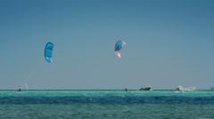kite surfing - surfers on blue sea surface - stock footage