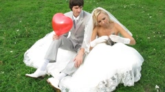 View from above on newlywed pair who poses for photographer Stock Footage