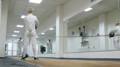 Two men fencing at Multisport fitness club Stock Footage