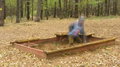 Boy play in wooden sandbox making molds Stock Footage