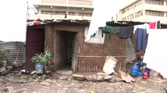 Children and laundry in an African slum - stock footage