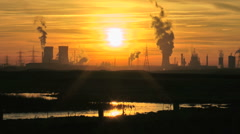 Cooling Towers with Steam Electric Pylons setting sun reflection in Salt Marsh Stock Footage