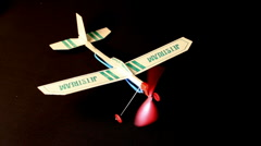 Toy airplane being wound up Stock Footage