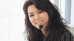 Pretty Smiling Chinese Call Center Agent Wearing A Telephone Headset Contact Us Stock Footage