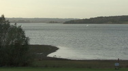 Long shot, dinghy crossing Rutland Water. Stock Footage