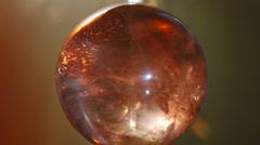 Moonstone crystal ball - orange back Stock Footage