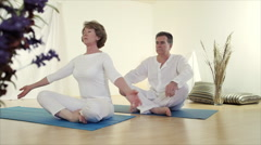 Man and woman meditate Stock Footage