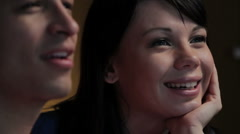Young Couple Watching a Movie, close up Stock Footage
