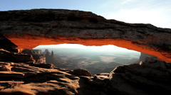 Desert Landscape Viewed Through Mesa Arch - stock footage