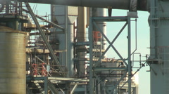 Industrial Plant emitting steam, with slow zoom out - stock footage