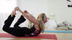 Yoga Bow to Child Pose Stock Footage