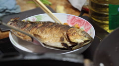 Chinese food: Cooking fish Stock Footage