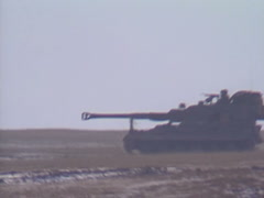 Military, British Army self-propelled AS90 artillery on the move Stock Footage