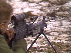 Military, soldier firing GPMG prone close up, shutter Stock Footage
