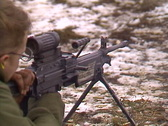 Stock Video Footage of military, soldier firing GPMG prone close up, shutter
